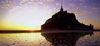 France - Mont St Michel (Manche, Basse Normadie): tidal island - sunset - UNESCO World Heritage Site - photo by W.Alg�wer