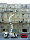 Le Havre, Seine-Maritime, Haute-Normandie, France: Cantilever Crane - painting a building - photo by A.Bartel