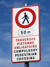 Le Havre, Seine-Maritime, Haute-Normandie, France: Bilingual 'No Pedestrians' sign, English, French - Compulsory Pedestrian Crossing sign - photo by A.Bartel