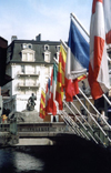 France / Frankreich -  Chamonix-Mont-Blanc (Haute-Savoi): on the bridge - flags and statue of G.Paccard - photo by M.Torres