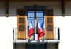 France / Frankreich -  Le Grand Bornand: town hall - French flags on the balcony (photo by K.White)