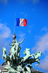 Paris, France: southeast corner of the Grand Palais - quadriga and the French flag - gravity defying sculpture 'L'Harmonie triomphant de la Discorde' by Georges Récipon - 8e arrondissement - photo by M.Torres