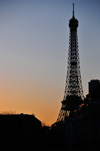 Paris, France: Eiffel Tower silhouette and mansard roofs of Rue de Grenelle at dusk - view from Les Invalides - photo by M.Torres