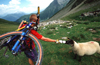 Chamonix, Haute-Savoi, Rh�ne-Alpes, France: a mountainbiker shares his water bottle with a sheep - Tour du Mont Blanc trail - photo by S.Egeberg