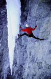 La Grave, Brian�on, Hautes-Alpes, PACA, France: iceclimber on free hanging icefall by a verticall rock wall - mountaineering - photo by S.Egeberg