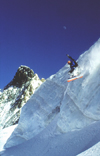 La Grave, Brian�on, Hautes-Alpes, PACA, France: off Piste snowboarder jumping on the glacier - photo by S.Egeberg