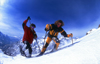 La Grave, Brian�on, Hautes-Alpes, PACA, France: two people snowshoeing up-hill in the snowy mountains - photo by S.Egeberg
