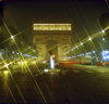 Paris, France: lights with starburst effect and horse-chestnut trees along Avenue des Champs-Élysées - nocturnal view of the Arc de Triomphe - 8th arrondissement - photo by J.Fekete