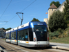 Caen, Calvados, Basse-Normandie, France: tram under the ramparts - the 'tramway' is in fact a guided-bus system built by Bombardier - photo by A.Bartel