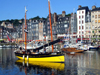 Honfleur, Calvados, Basse-Normandie, France: sail boat at the Vieux Bassin - buildings on Quai Sainte-Catherine - photo by A.Bartel