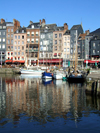 Honfleur, Calvados, Basse-Normandie, France: entrance to the Vieux Bassin, the old harbour - buildings on Quai Sainte-Catherine - photo by A.Bartel