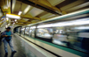 Paris, France: man on metro platform - blurred train in motion, Champs-�lys�es�Clemenceau station - 8e arrondissement - photo by K.Gapys
