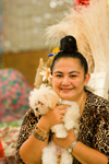 Papeete, Tahiti, French Polynesia: Tahitian woman wearing a leopard pattern, accompanied by her dog - photo by D.Smith