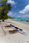 Papetoai, Moorea, French Polynesia: outrigger boat on a fine white sand beach - photo by D.Smith