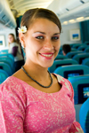 Faa'a International Airport, Tahiti, French Polynesia: a Air Tahiti Nui airlines hostess wearing traditional ethnic and cultural attire of Tahiti - photo by D.Smith