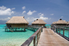 Papetoai, Moorea, French Polynesia: InterContinental Hotel - a pontoon leads to the overwater bungalows - photo by D.Smith