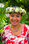 Papeete, Tahiti, French Polynesia: smiling Tahitian woman, wearing a flower garland - photo by D.Smith