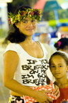 Papeete, Tahiti, French Polynesia: portrait of a Tahitian woman wearing a flower garland and her daughter - photo by D.Smith