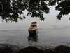 Gabon - Cap Estérias - Estuaire province: boat by the shore and the forest - photo by B.Cloutier