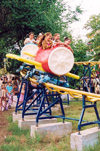Comrat / Komrat, Gagauzia, Moldova: children on a roller coaster - amusement park in the town center - photo by M.Torres