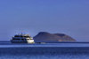 Galapagos Islands - Isla Tortuga: vessel and volcano - only the upper ring of the crater breaches the surface of the Pacific ocean - photo by R.Eime