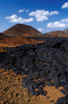 Bartolomé Island, Galapagos Islands, Ecuador: lava field and small volcano - photo by C.Lovell