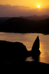Bartolomé Island, Galapagos Islands, Ecuador: Pinnacle Rock and the sea at sunset - photo by C.Lovell