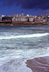 Galicia / Galiza - A Coruña: waves and and city skyline in the background - photo by S.Dona'
