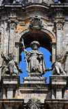 Santiago de Compostela, Galicia / Galiza, Spain: the Cathedral - statue of St. James the Great in the center of the gable, with his two disciples Athanasius and Theodomir, represented as pilgrims - photo by M.Torres