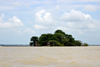 James Island / Kunta Kinteh island, The Gambia: the island seen from the north, with Fort James mostly hidden by baobab trees - UNESCO world heritage site - photo by M.Torres