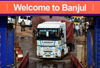 Banjul, The Gambia: a trucks struggles to board the ferry to Barra, across de river Gambia - photo by M.Torres