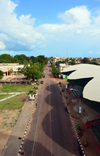 Banjul, The Gambia: view along Independence drive, the capital's tree-lined main avenue and skyline of the low-rise Gambian capital with the military parades' stand in the foreground - photo by M.Torres