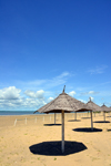 Banjul island, The Gambia: beach with golden sand beach on the north shore of Banjul Island, near the Laico Atlantic hotel - beach umbrellas and deep blue sky - photo by M.Torres