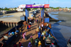 Barra, The Gambia: ferry terminal pier - passengers leave the ferry, while trucks, mostly from Senegal, wait their turn to cross the River Gambia to Banjul - photo by M.Torres