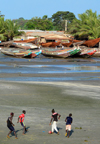 Barra, The Gambia: beach soccer against a background of wooden fishing boats - photo by M.Torres