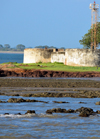 Barra, The Gambia: bastions of Fort Bullen at Barra Point - fort and ligh navigation light at the estuary of the River Gambia - UNESCO world heritage - photo by M.Torres
