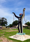 Albreda, Gambia: Emancipation Statue, slavery sculpture with 'never again' at the base - broken chains, globe head and oddly the Berber symbol on the chest - photo by M.Torres