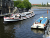 Berlin, Germany / Deutschland: tour boats on the river Spree - photo by M.Bergsma