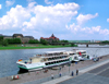 Dresden, Saxony / Sachsen, Germany / Deutschland: tour ship on the Elba river - in the background the Saxonian State Ministry of Finance, the Saxonian State Chancellery and the GDR built Carolabrücke bridge - photo by E.Keren