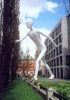 Germany - Bavaria - Munich / M�nchen: a giant among us - Walking Man sculpture, Jonathan Borofsky - Munich Re HQ, the world�s biggest reinsurance company - M�nchner R�ck - modern art - sculpture - photo by M.Torres