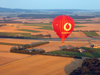 Würzburg Kreis, Lower Franconia, Bavaria, Germany: Vodafone baloon flies over farms - from the air - photo by D.Steppuhn