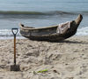 Accra, Ghana: Jamestown district - beach - canoe and shovel on the sand - photo by G.Frysinger