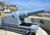 Gibraltar: gun at Harding's Battery, Europa Point, behind it is the Sunni Mosque of The Custodian of the The Holy Mosques -  photo by M.Torres
