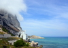Gibraltar: view along Sir Herbert Miles Road towards Catalan Bay - orographic clouds, Caleta Hotel and newly reclaimed land - photo by M.Torres