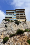 Gibraltar: cliffhanger apartment buildings in front of the Devil's Bellows - on The Rock space is precious, civil engineers and architects have to be creative - photo by M.Torres