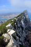 Gibraltar: view along the ridge and cliff of the Rock towards Middle Hill - La Linea in Spain in the background - Upper Rock Nature reserve - photo by M.Torres