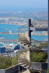 Gibraltar: spiral stairs at the cable car summit station with the airport and La Linea in the background - photo by M.Torres