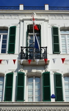 Gibraltar: balcony with Swiss flag on Main Street - Turicum Bank - photo by M.Torres