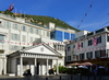 Gibraltar: Guard House of the residence of the Governor of Gibraltar and The Angry Friar pub on Convent Place, Main Street - cable car in the backround - photo by M.Torres