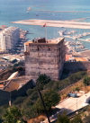 Gibraltar: the Union Jack over an old Arab bastion - Tower of Homage - Moorish Castle - photo by Miguel Torres